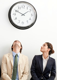 Employees watching the clock